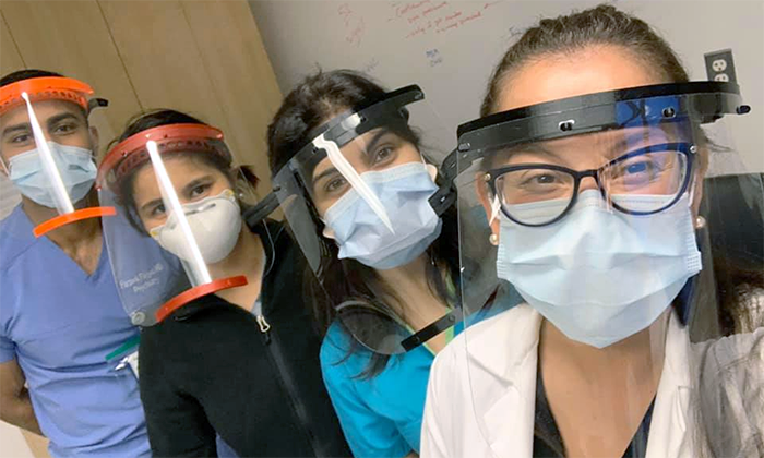 Medical staff from Elmhurst Hospital wearing the face shields