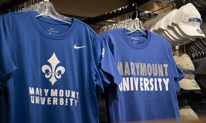 Photo of two blue Marymount University tee shirts