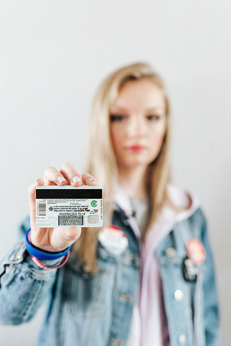 Kaylee Tyner holding her driver's license as part of the #MyLastShot campaign