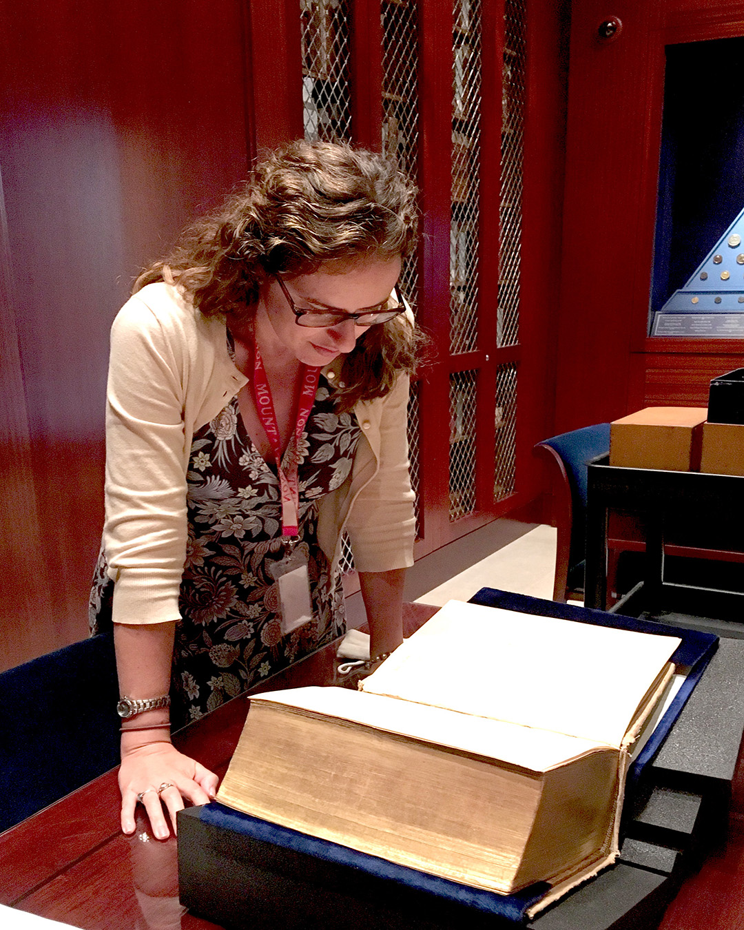 Dr. Cassie Good reads a book inside the Washington Library at Mount Vernon