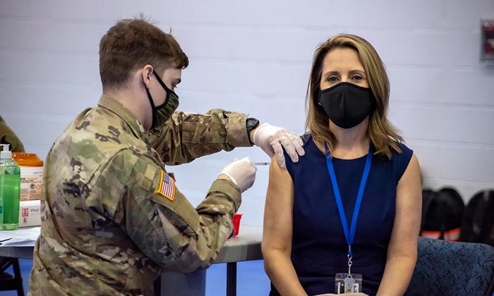 Marymount staff member Diana Talbert receiving the COVID-19 vaccine