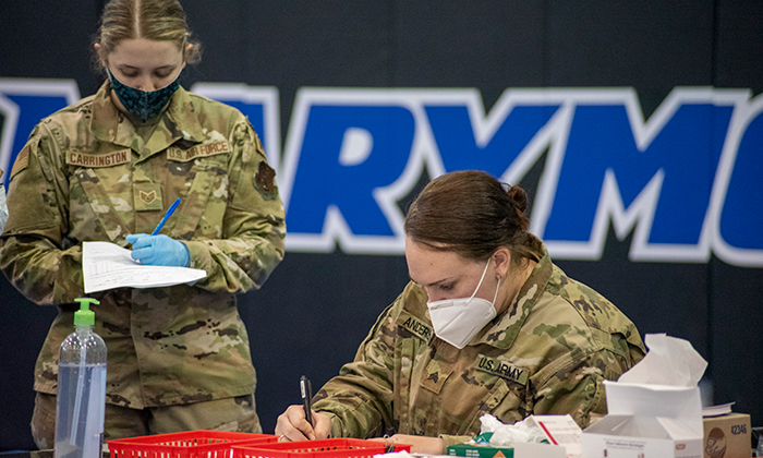 Members of the Army National Guard distributing COVID-19 vaccines at Marymount's clinic