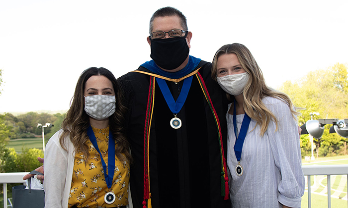 Phi Kappa Phi chapter awards coordinator Dr. Todd Rimkus, center, with inductees Danielle Leff, left, and Kathleen Miller, right.
