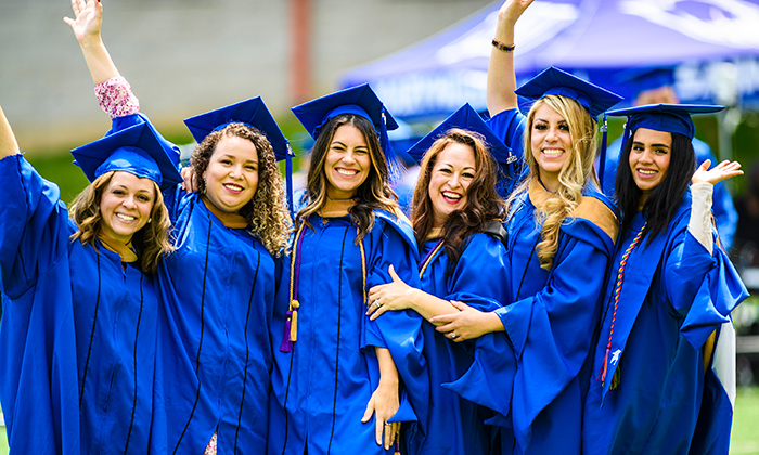 Graduates from Marymount University's College of BILT celebrate together following the ceremony