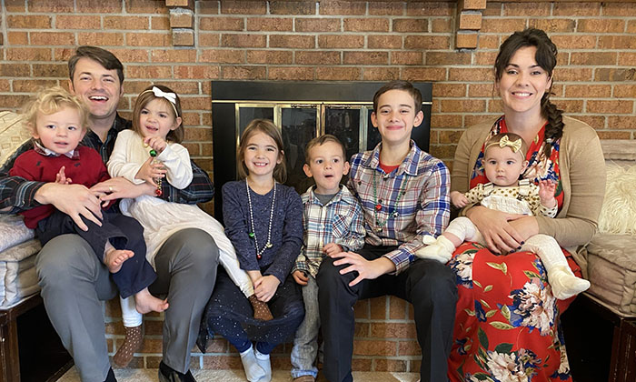 Marymount Nursing student Nicholaus Huff smiles alongside his wife and six children.