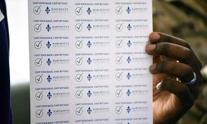 Stickers from Marymount University COVID-19 vaccination clinic