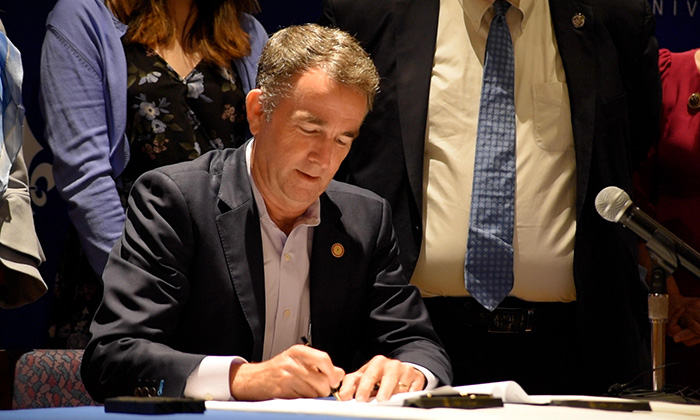 Governor Northam signing legislation to extend financial aid
