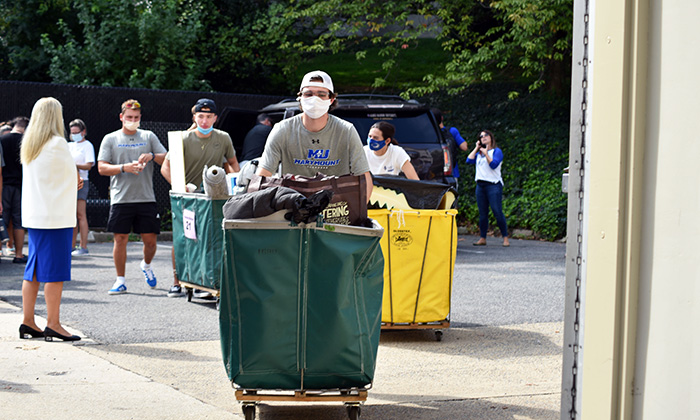 New Marymount students move into their residential living spaces in Rowley Hall on Move-In Day
