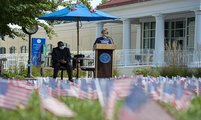 Student Stef Socher reads the names of those who died on 9/11