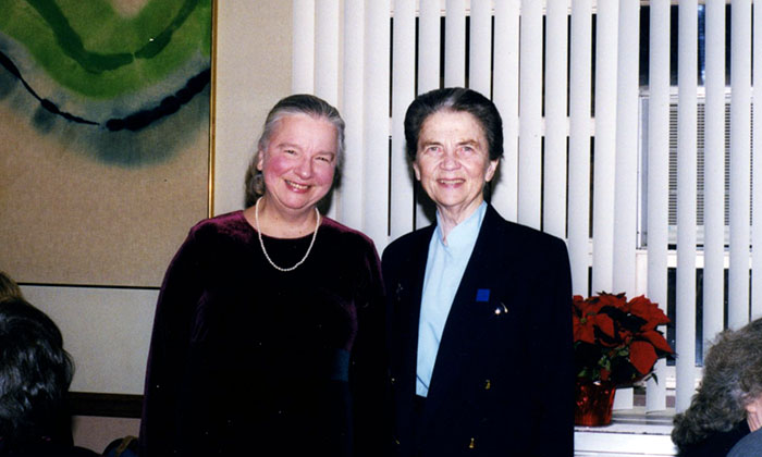 Dr. Lillian Bisson receiving the 30-Year Service Award from MU President, Sr. Eymard Gallagher, on December 21, 1999