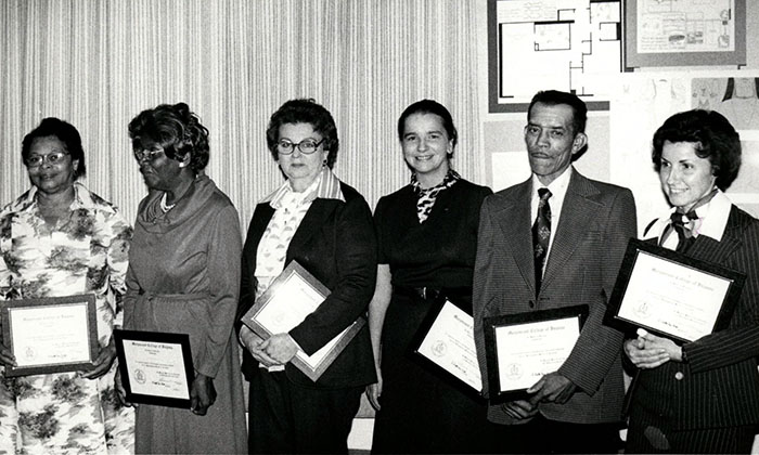 Dr. Lillian Bisson, fourth from left, at the first Recognition Dinner & Anniversary (Service Awards) on October 13, 1977